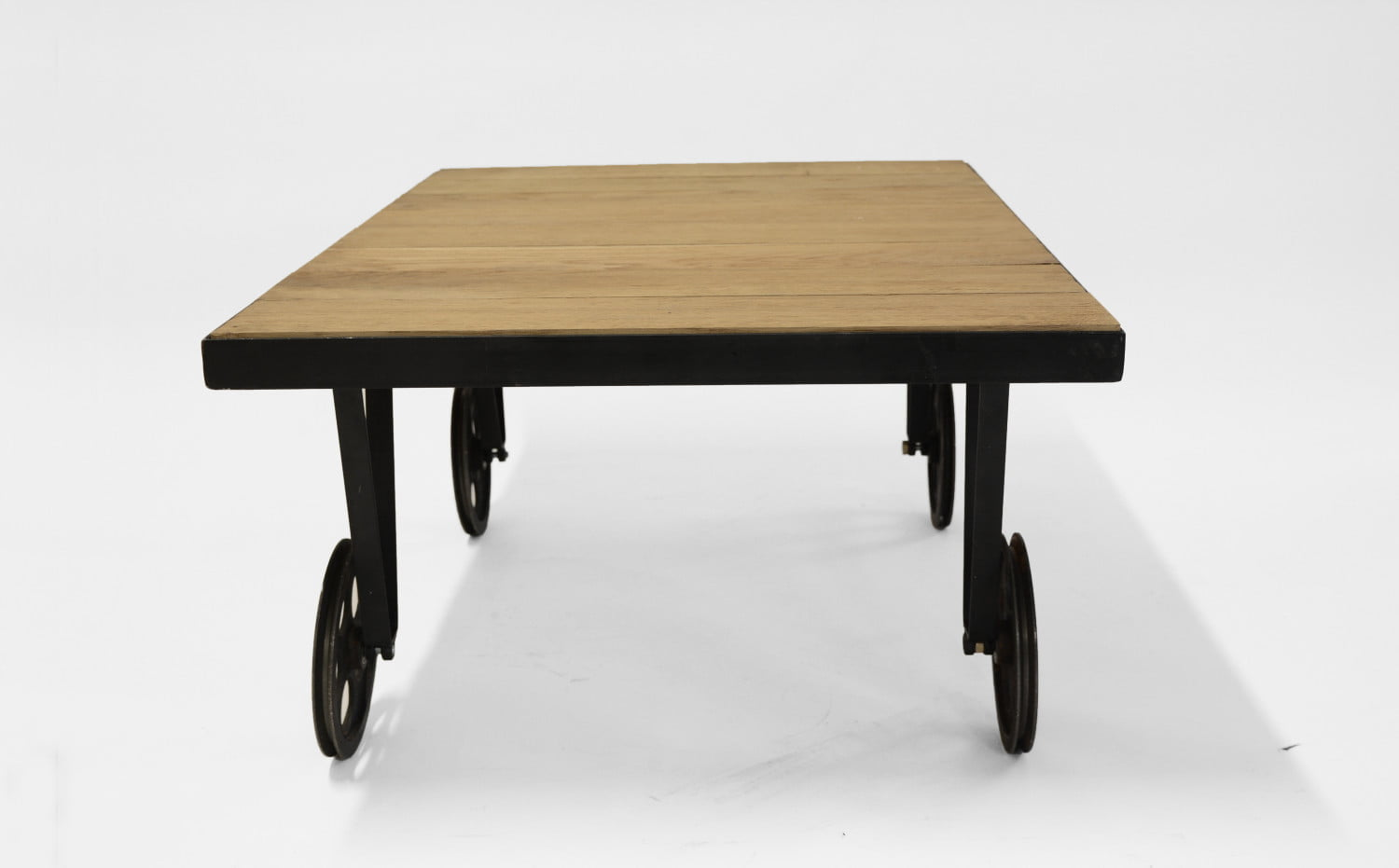 Oak coffee table on wheels with a brushed wooden top