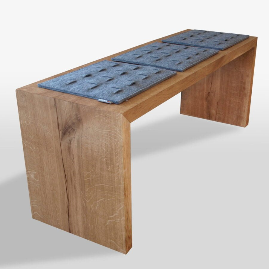 oak wooden simple minimalist bench with red felt grey pads
